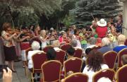 "Picture of ""Strings in the Summer"" students performing last July at Sierra Place"