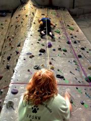 Susan Shinn Cesarini belays climber Lisa Wallace