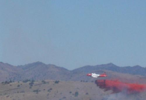 P3 airtanker dumps retardant on wildfire near Carson City, Nevada